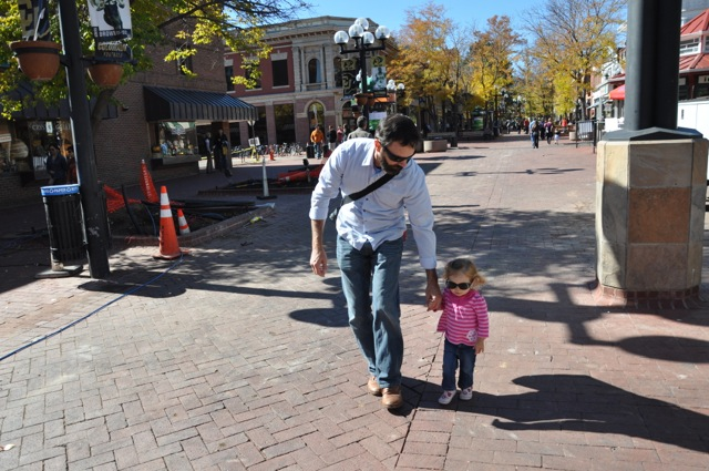 Walking with Daddy in Boulder.