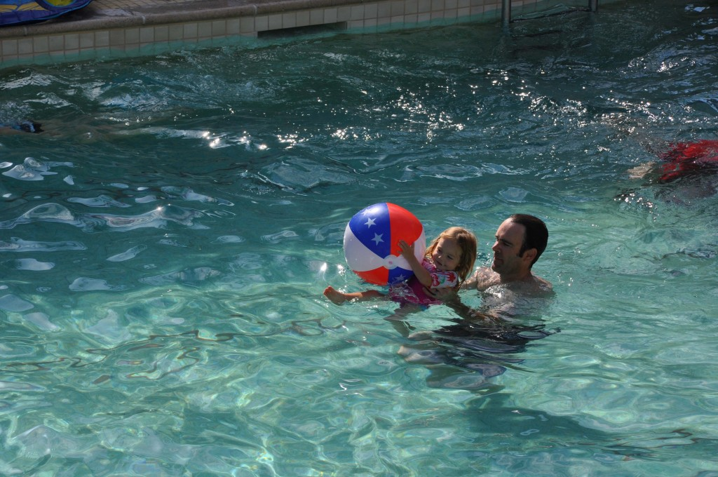 Playing with Daddy in the pool.