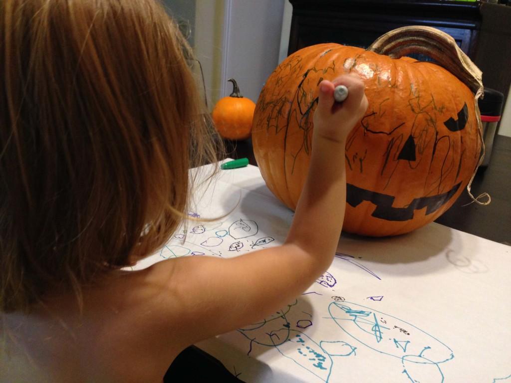 Having fun decorating pumpkins!