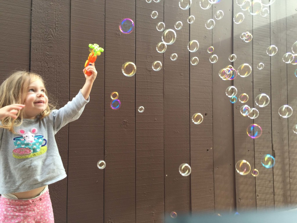 L.L. loved her bubble gun that Nana brought.