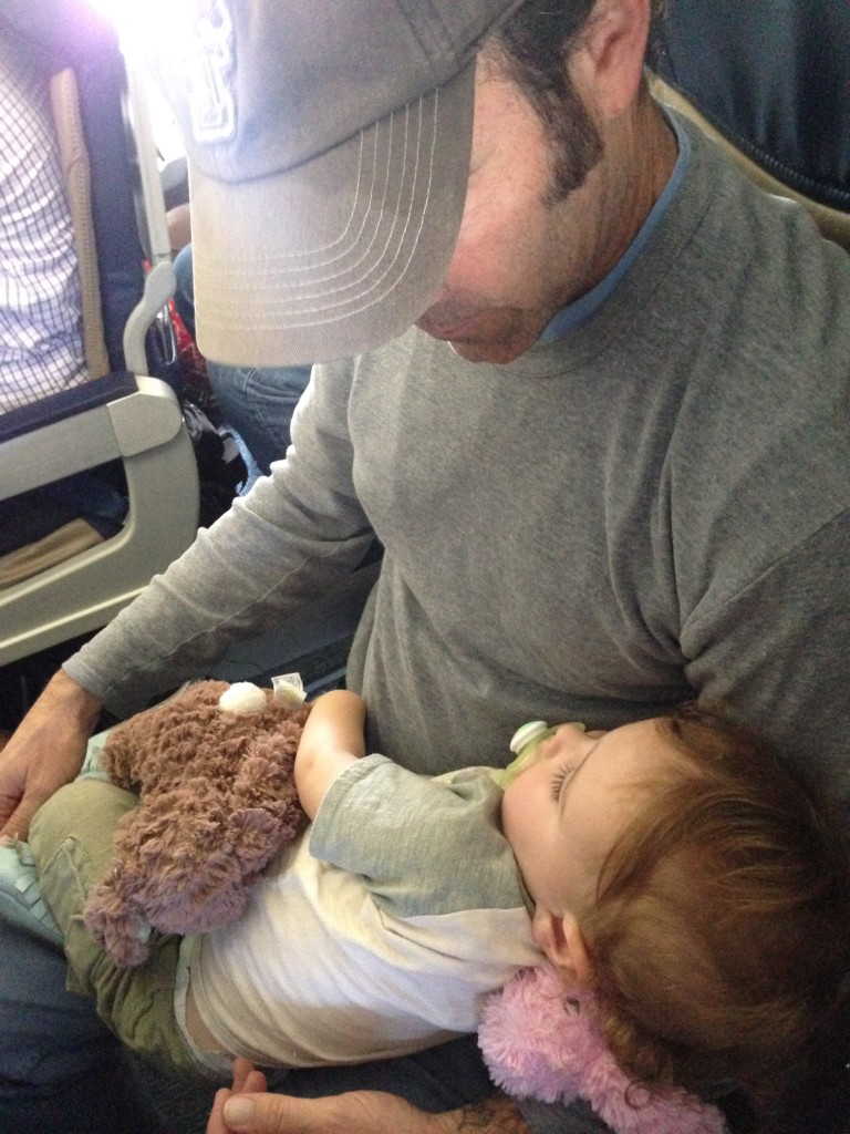 His first flight, napping on Daddy.